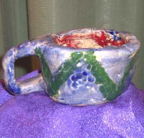 Click to read: Multi-colored mug | YourClayProject.com